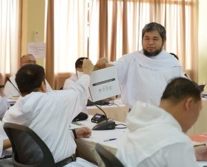 Bro. Jazeel Jakosalem collecting ballot during the election of the Prior Provincial for the 7th Provincial Chapter of Saint Ezekiel Moreno. photo courtesy of chapter.rekoletosfilipinas.org